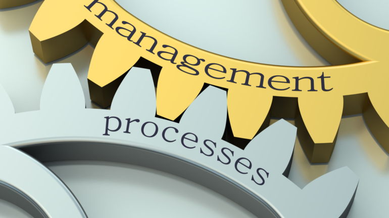 Management Processes concept on the gearwheels